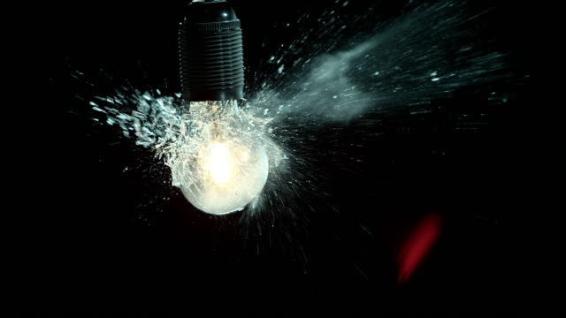 SLO MO clear lit light bulb exploding