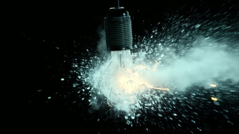 slo mo clear lit light bulb explosion - impact stock videos & royalty-free footage