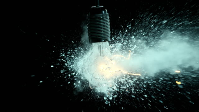 SLO MO clear lit light bulb explosion