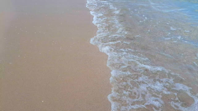 clear sea waves over sand beach background - grace bay stock videos and b-roll footage