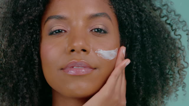 clear skin makes her feel beautiful - body care stock videos & royalty-free footage