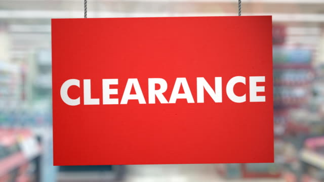 clearance sign hanging from ropes. luma matte included so you can put your own background. - price tag stock videos & royalty-free footage