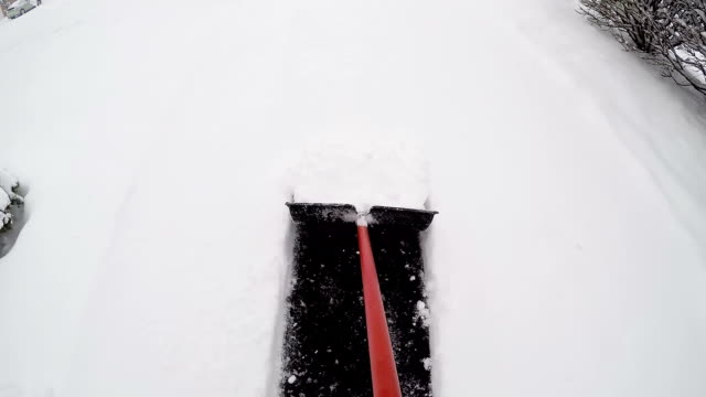 clearing a path in the snow - spade stock videos & royalty-free footage