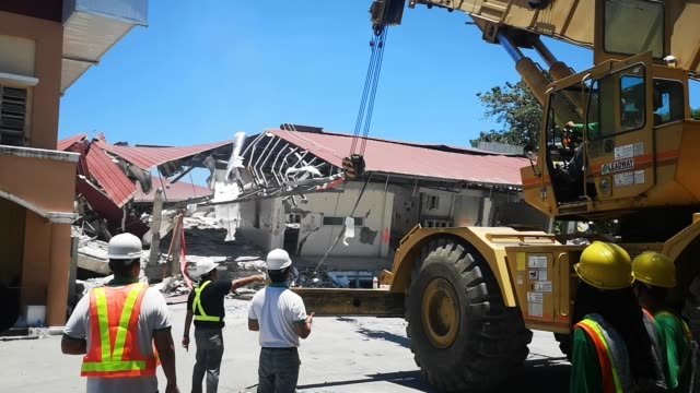 clearing operations and rebuilding of heavily devastated buildings in porac pampanga started after a 61 magnitude earthquake damages central luzon... - luzon stock videos & royalty-free footage