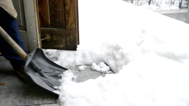 clearing snow from balcony - spade stock videos & royalty-free footage