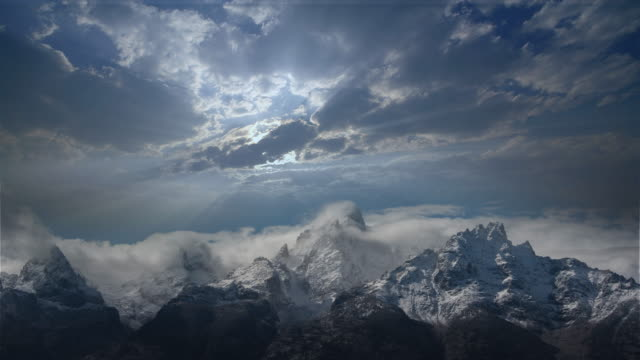 clearing snow storm over rocky mountain range, grand teton national park, wyoming - montagne rocciose video stock e b–roll