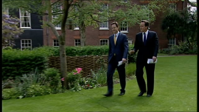 clegg and cameron along lawn to press conference david cameron mp press conference with nick clegg beside sot - we just sort of looked at it and... - politics and government点の映像素材/bロール