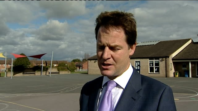 clegg visits primary school in cheltenham ext nick clegg mp interview sot talks of job losses at the augustawestland factory in yeovil / huge blow... - ニック クレッグ点の映像素材/bロール