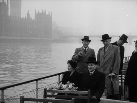 """clement attlee and his wife, travel on the new london water bus """"festival"""" as it makes its way past the houses of parliament. - houses of parliament london stock videos & royalty-free footage"""