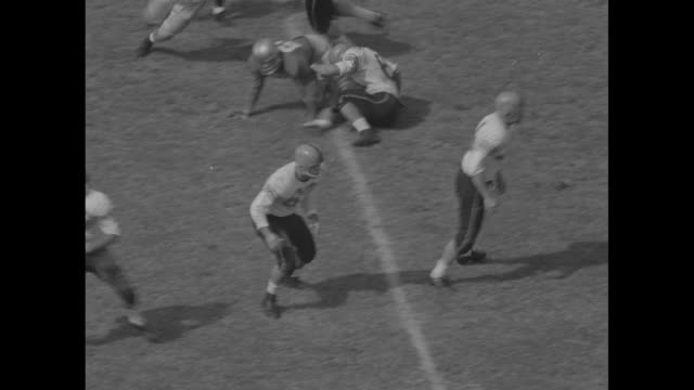 stockvideo's en b-roll-footage met clemson kick off / clemson inabinet tackle passes to joe pagliei forced out of bounds / #67 billy oõdell around end / clemson don king passes to... - billy joel