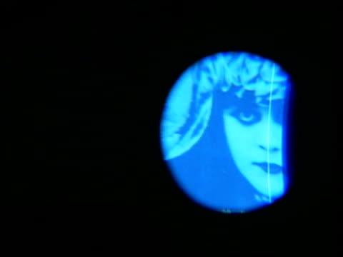 cleopatra exhibition theda bara as cleopatra highlighted by spotlight tve television camera filming still of theda bara - cleopatra stock videos & royalty-free footage