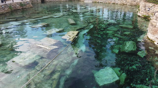 cleopatra's ancient pool in pamukkale, turkey - hot spring stock videos & royalty-free footage