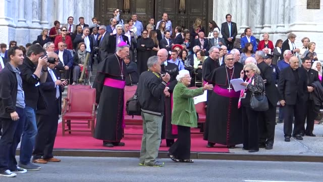 clergy pose for pictures at st patrick's cathedral / annual columbus day parade via 5th avenue in manhattan new york city usa - st. patrick's cathedral manhattan stock videos and b-roll footage