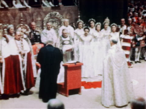 1953 clergyman kneeling giving bible to queen elizabeth ii in coronation ceremony / documentary - coronation stock videos and b-roll footage