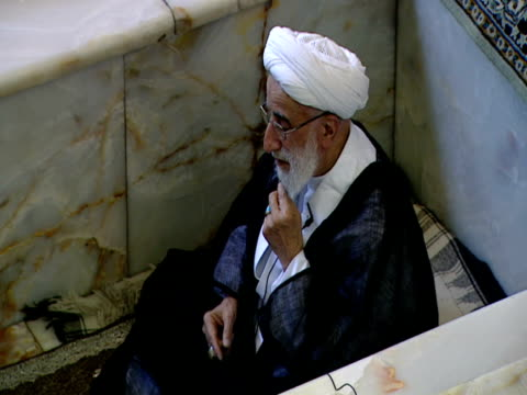 cleric seated in marble cubicle leading congregation of worshipers during midday prayer / qom iran - midday stock videos and b-roll footage