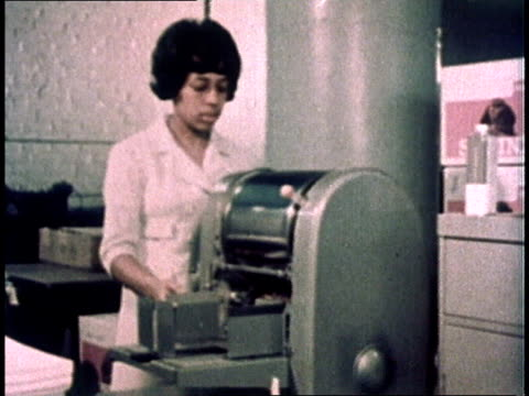 1967 montage clerk operating mimeograph machine / usa - photocopier stock videos and b-roll footage