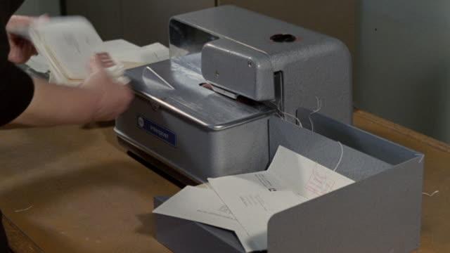1968 ha clerk running envelopes through postage machine / united kingdom - file clerk stock videos & royalty-free footage