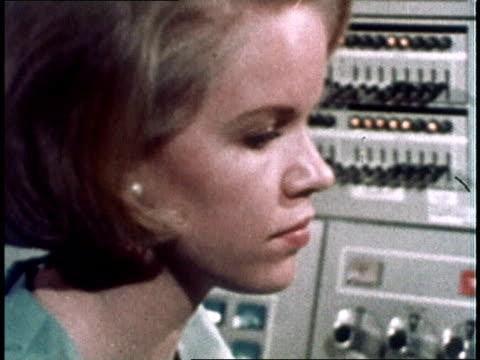 1967 montage clerk typing on electric typewriter then turning to switchboard / usa - file clerk stock videos & royalty-free footage