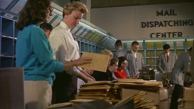 ms clerks at work in mail dispatching center / washington d.c., united states - post office stock videos and b-roll footage