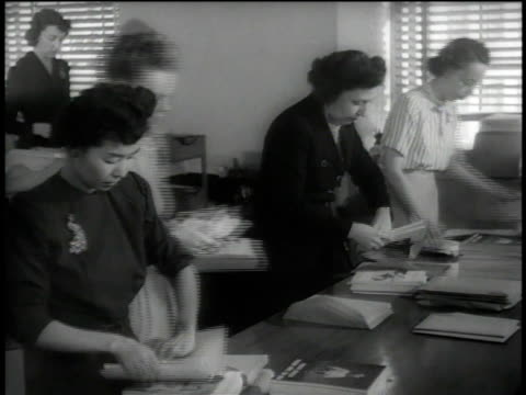 1946 ms clerks stuffing envelopes / united states - east asian ethnicity stock videos & royalty-free footage