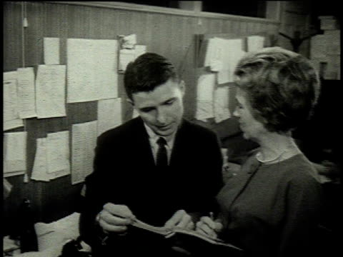 1962 montage clerks working in an office / baltimore, maryland, united states - notice board stock videos and b-roll footage