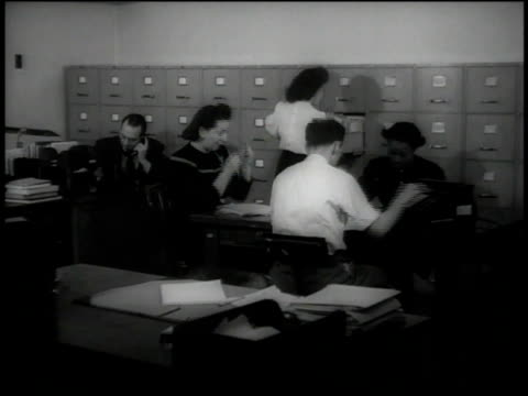 1946 montage clerks working in an office with a lot of filing cabinets / united states - filing documents stock videos and b-roll footage