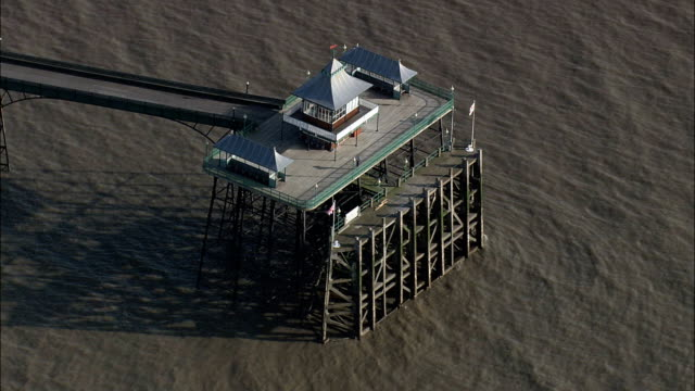 clevedon pier  - aerial view - england,  north somerset,  clevedon helicopter filming,  aerial video,  cineflex,  establishing shot,  united kingdom - clevedon pier stock videos & royalty-free footage