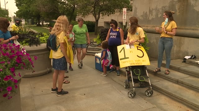 wjw cleveland oh us masked people with placards gathering on sidewalk a group gathered at cleveland city hall for a demonstration followed by a... - human trafficking stock videos & royalty-free footage