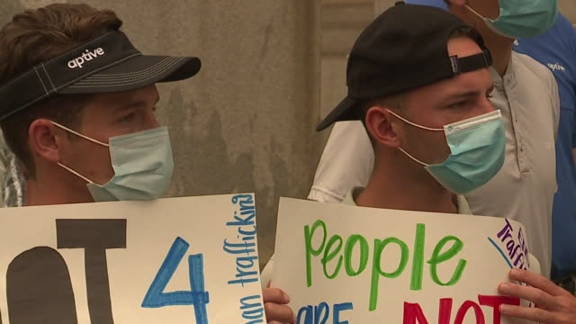 wjw cleveland oh us people with placards protesting on steps of city hall a group gathered at cleveland city hall for a demonstration followed by a... - human trafficking stock videos & royalty-free footage