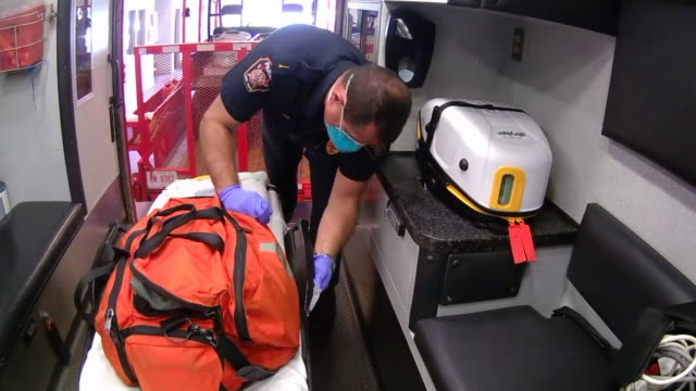 cleveland, oh, u.s. - sanitizing of ambulace interior to prevent covid-19 spread. ems crews are putting ambulances through a deep cleaning, sometimes... - paramedic stock videos & royalty-free footage