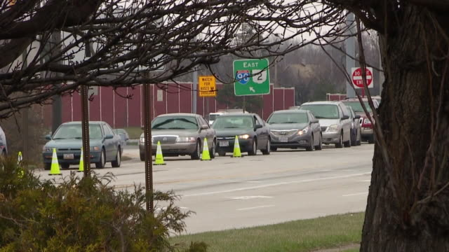 cleveland, oh, u.s. - the bumper-to-bumper traffic to food bank during covid-19 outbreak on tuesday, march 24, 2020. - traffic jam stock videos & royalty-free footage