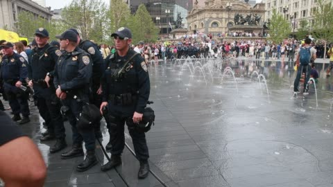 cleveland, ohio, usa: members of the california highway partrol stand guard in public square during protests on the final day of the 2016 republican... - guarding stock videos & royalty-free footage