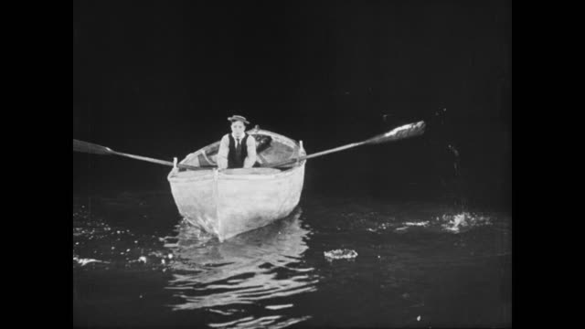 1923 clever cabin boy (buster keaton) sabotages pirate ship so it sinks then calmly waits for lifeboat to float to his escape - 1923 stock videos & royalty-free footage