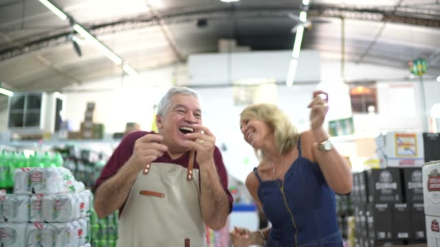 client and employee dancing at wholesale - carefree stock videos & royalty-free footage