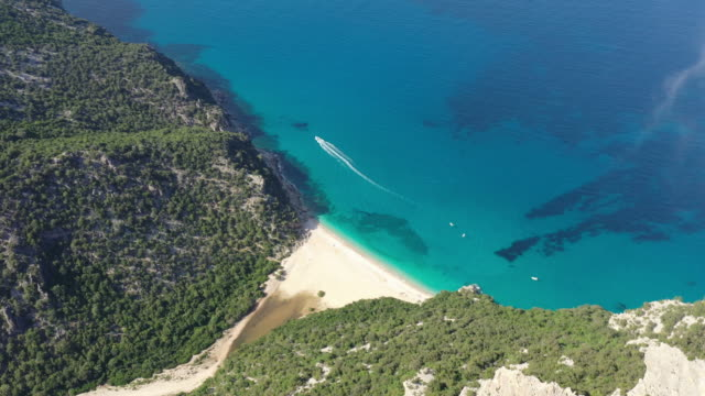 cliff and secret beach in sardinia - spiaggia stock videos & royalty-free footage