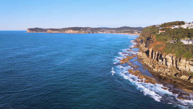 cliff and village at terrigal beach / australia - tourism stock videos & royalty-free footage