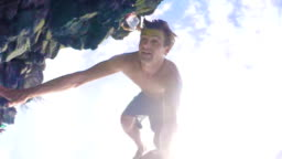 POV Cliff Jumping Backflip in HD Slow Motion.