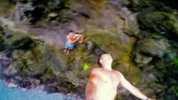 Cliff Jumping in Hawaii. Summer Fun Lifestyle.