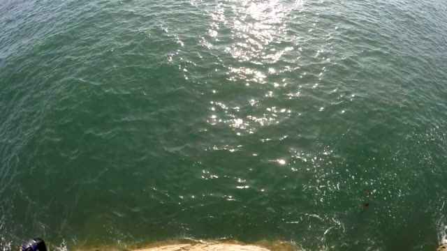 pov - cliff jumping - cliff stock videos & royalty-free footage