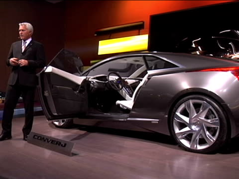 cliff, our onstage narrator, tells the audience all about the cadillac converj plug-in hybrid concept car. it's based on the chevrolet volt but with... - narrating stock videos & royalty-free footage