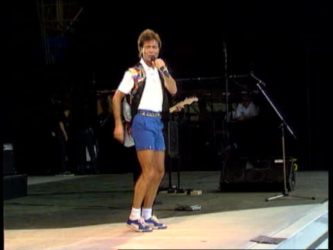 cliff richard 40 years in the music business wembley stadium ext cliff wearing shorts performing 'living doll' in concert with the shadows - shorts stock-videos und b-roll-filmmaterial