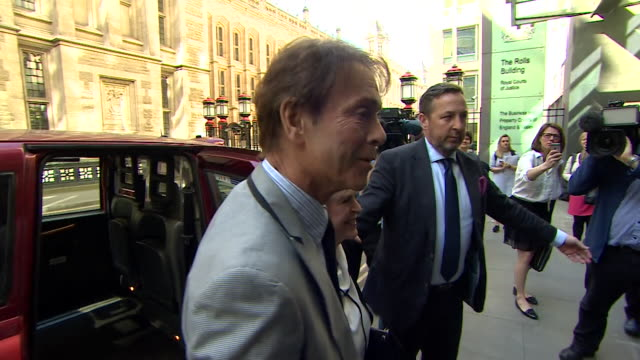 Cliff Richard and Gloria Hunniford arriving at court where the singer is suing the BBC for invasion of privacy