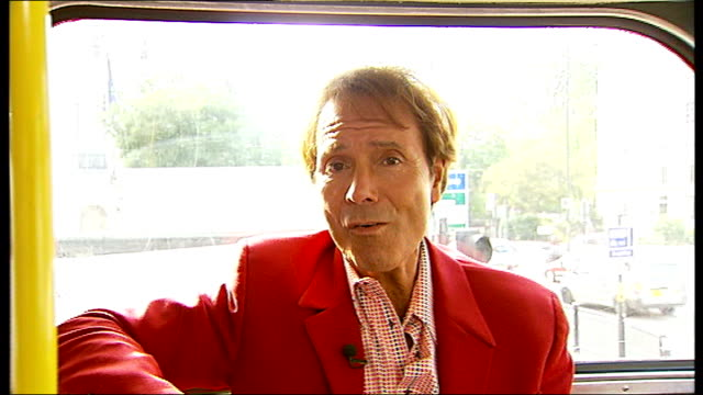 cliff richard celebrates fiftieth anniversary of career sir cliff richard interview sot performs 'summer holiday' song acapella number 9 routemaster... - number 9 stock videos and b-roll footage