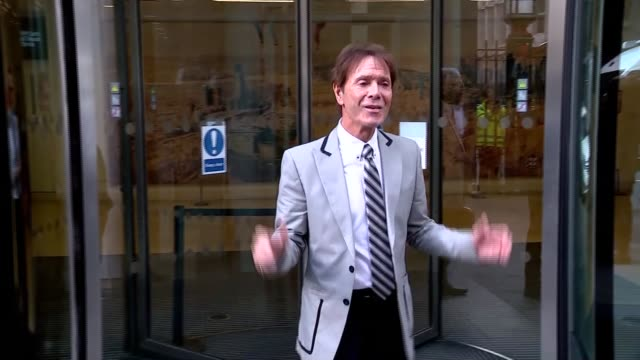 cliff richard departure england london high court rolls building photgraphy*** cliff richard along from building with legal team as waving / richard... - cliff richard stock videos and b-roll footage