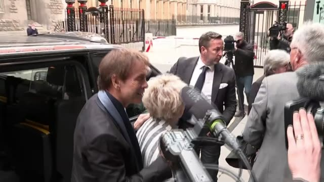 cliff richard criticises bbc over raid footage; england: london: royal courts of justice: ext sir cliff richard and gloria hunniford along from car... - gloria hunniford stock videos & royalty-free footage