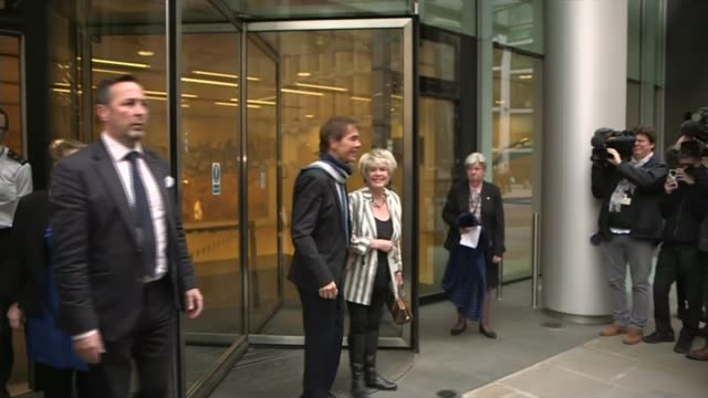 cliff richard criticises bbc over raid footage; high court: ext various of cliff richard and gloria hunniford from court and waving to cameras along... - グロリア ハニフォード点の映像素材/bロール