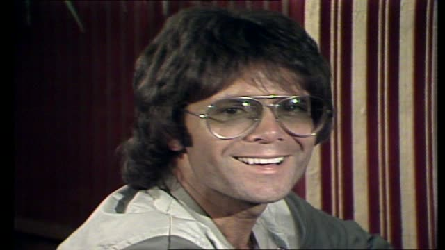 cliff richard interview with donnie sutherland in a hotel lounge continues re his future direction and goals his changed attitude towards australia... - cliff richard stock videos and b-roll footage