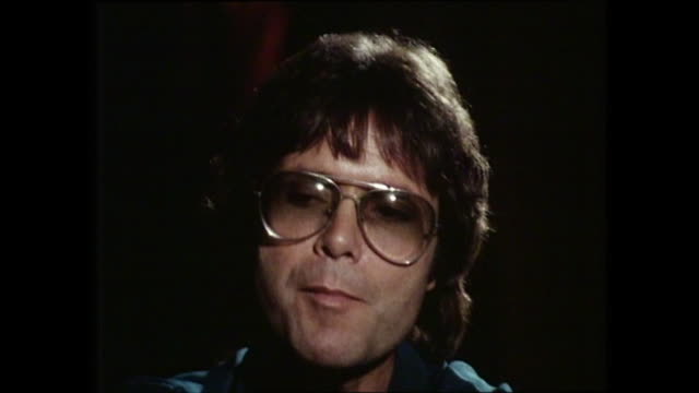 cliff richard interview with donnie sutherland re song writing - cliff richard stock videos and b-roll footage