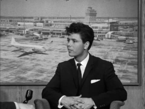 cliff richards interview on return from south africa england london airport cliff richard is interviewed by brian wildlake - cliff richard stock videos and b-roll footage