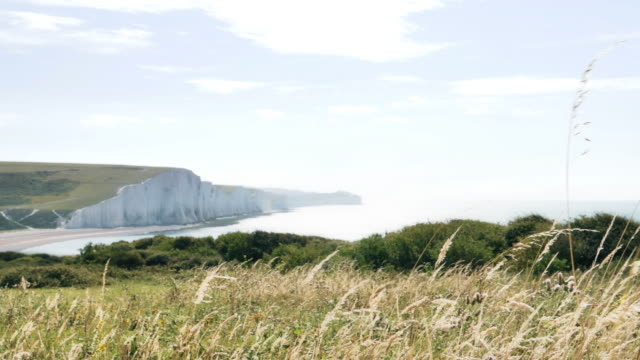 Cliffs and sea at Cuckmere, East Sussex, England.  Slow mo. WS.